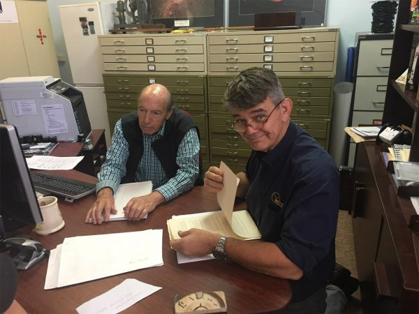 Andrew Markerink and Michael Myers inspect original drawings of the Shortt Synchronomes. Image Credit: Paul Fisher