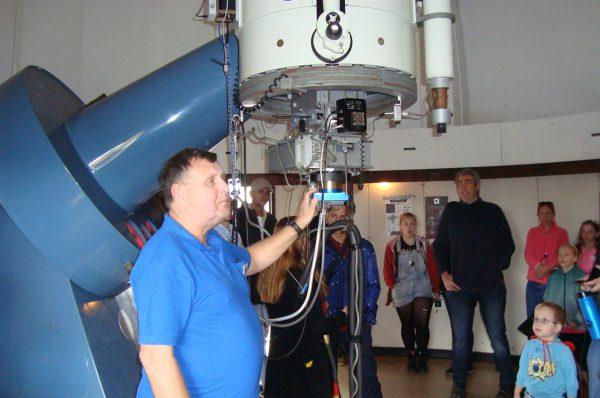 Volunteer Ed talking about the lowell telescope. Image Credit: Geoff Scott