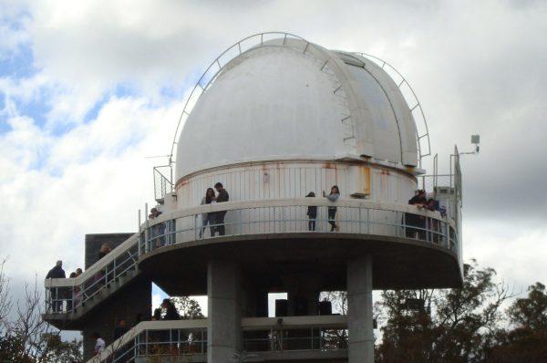 Group walking around lowell dome. Image Credit: Geoff Scott