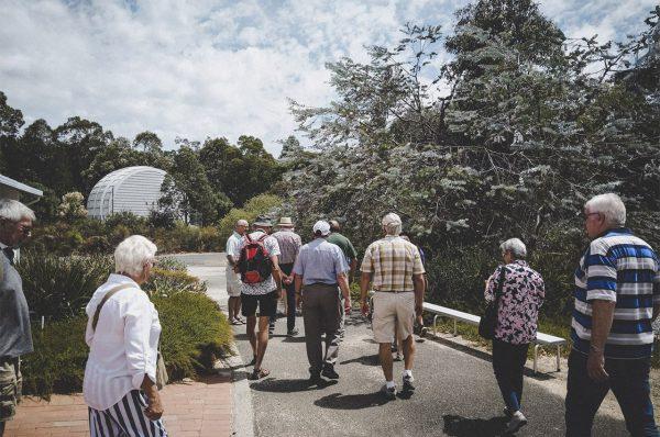 Day tour group walking to the Meredian Telescope. Image Credit: Matt Woods