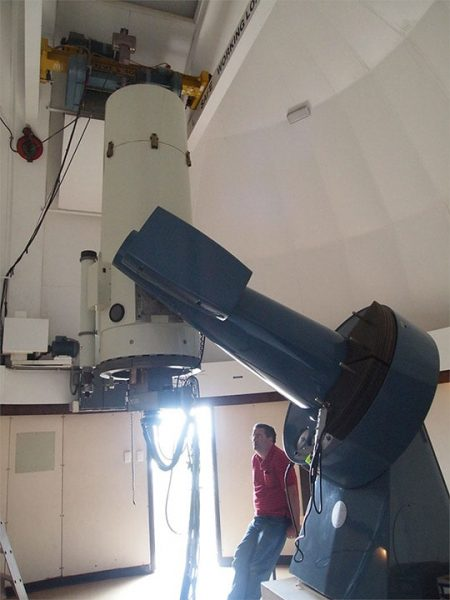 The Perth-Lowell Telescope with one of the people who automated it, Dr Andrew Williams. Image Credit: Matt Woods