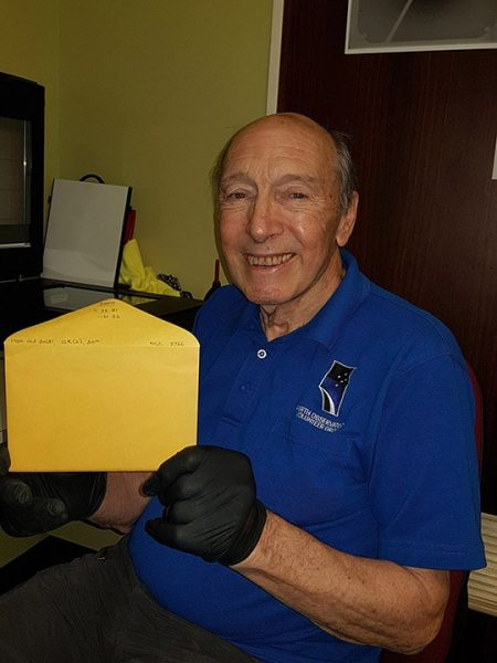 Volunteer Michael with the 20,000 scanned glass plate's sleeve. Image Credit: Sue Knight