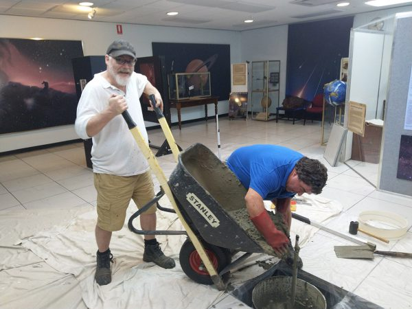Paul and Rob pouring cement in the Museum. Image Credit: Matt Woods