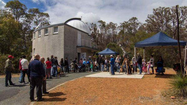 People safely looking through solar telescopes. Image Credit: Geoff Scott
