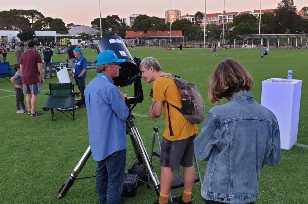 Volunteer Gary showing the Moon through our CPC1100 telescope at Astrofest. Image Credit: ICRAR